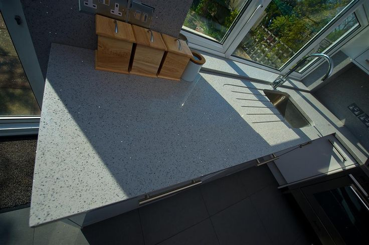 Grey sparkly quartz worktops by The Marble Store