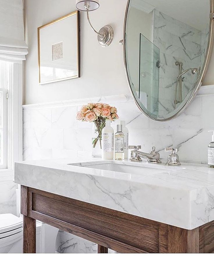 This sink and vanity combo is Stunning bathroom design by @marieflaniganinteriors