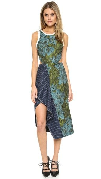 Side cutouts lend a modern element to this romantic, mixed-material 3.1 Phillip Lim dress. Asymmetrical hem. V back with hidden hook-and-eye closures. Sleeveless. Hidden side zip. Lined.