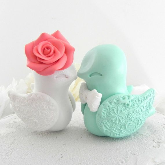 Love Bird Wedding Cake Topper, Coral, White and Mint Green, Bride and Groom Keepsake, Fully Custom. The most adorable little Love Birds Wedding Cake Topper in Coral, White and Mint Green! These beautiful Love Birds will add a whole lot of cuteness to your beautiful cake! Simple, elegant and irresistibly cute! She has a beautifully sculpted rose and he has an adorable little tie and boutonniere. Their wings have a beautifully impressed lace design