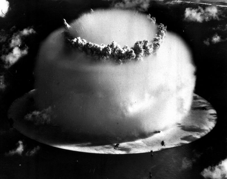 A huge mushroom cloud rises above Bikini atoll in the Marshall Islands on July 25, 1946 following an atomic test blast, part of the U.S. military's Operation Crossroads. The dark spots in foreground are ships that were placed near the blast site to test what an atom bomb would do to a fleet of warships. (AP Photo) #