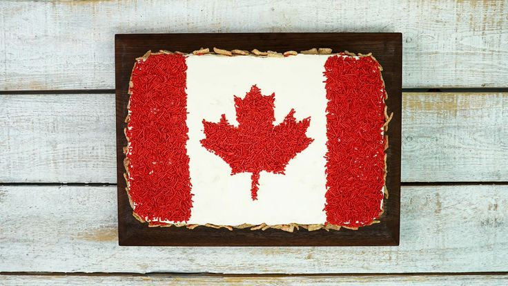 Canada 150 Flag Cake recipe and reviews - Using Cinnamon Toast cereal adds a delicious and satisfying crunch to this festive Canada flag cake.