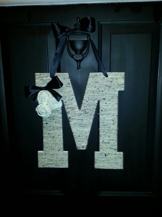 Decorate your front door. Wooden letter, yarn and ribbon