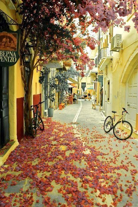 Beautiful Side Street in Chania, Crete - Greece - The second largest city on the island of Crete is my favorite!! The town has historical interest, the restaurants are plentiful, great hotels and a nightlife as good as anyplace else in Europe. Make sure you rent a car and drive around the local suburbs and villages. Culture shock in a good way.