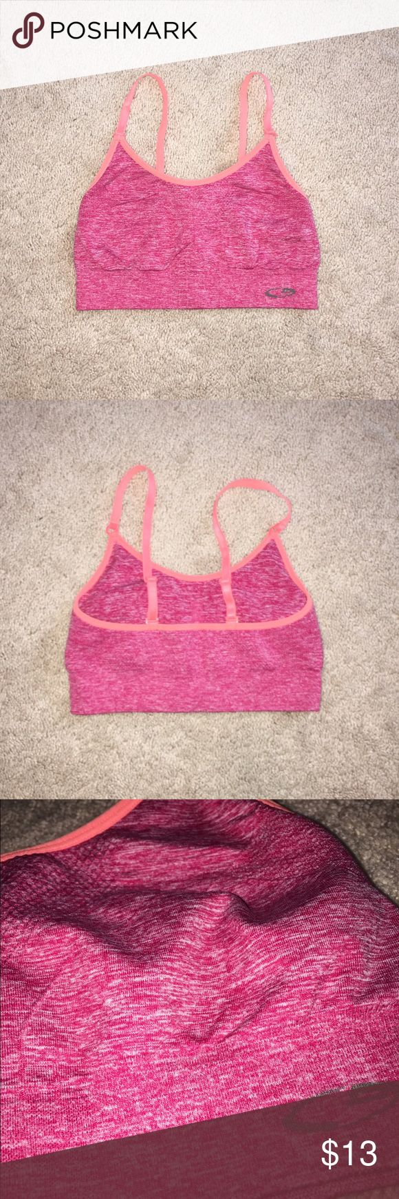 Champion Pink and Orange Sports Bra originally $19.99 size XS, fits true to size, could fit a small as well brand: Champion, purchased at Target  condition: like new, worn a few times  color: heathered raspberry pink and orange  ❤️super comfortable  ❤️adjustable straps  ❤️no padding ❤you ️don't nip through it lol ❤️low impact  ❤️perfect for lounging, yoga, etc Champion Intimates & Sleepwear Bras
