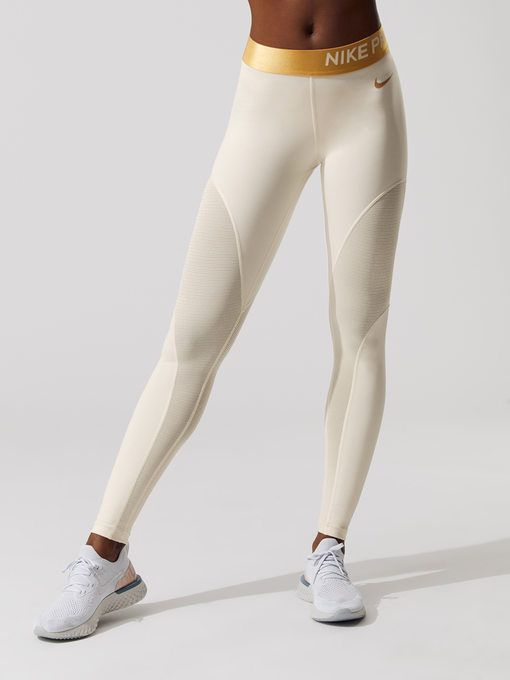6b382ecd8892d NIKE Nike Pro Warm Women's 7/8 Tights Light cream/Metallic gold 7/8 LENGTH  LEGGINGS