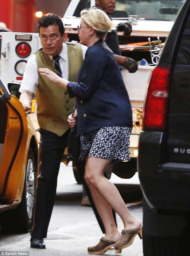 Scarlett Johansson hides her baby bump under a chic blazer as she hails a cab in New York http://dailym.ai/1l03el3