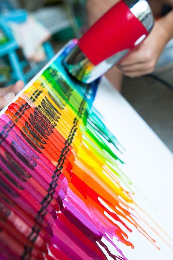 Melting crayons to make a unique rainbow canvas