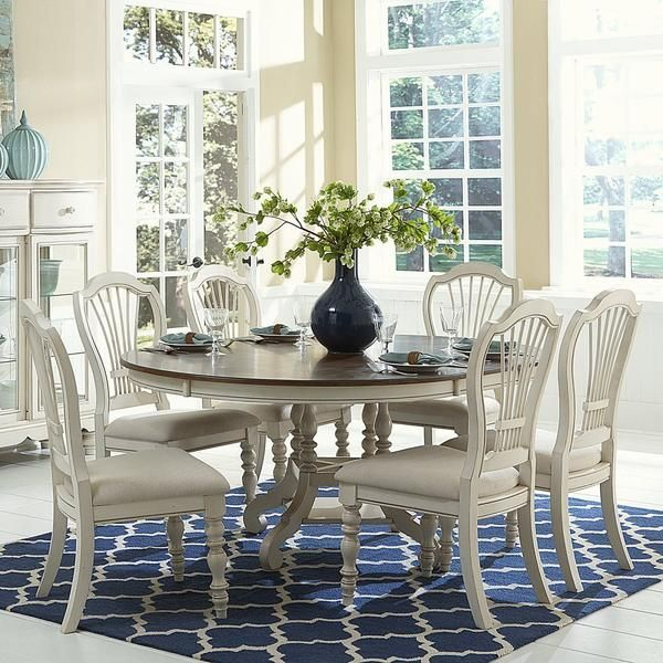 Pastoral elegance is the hallmark of Hillsdale's Pine Island Round Dining Room Table. Available in either a solid Dark Pine finish, or an Old White finish with