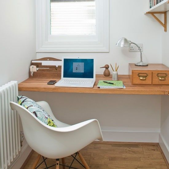 Traditional mid-century style office  Fresh white walls with with retro inspired furniture makes an easy-living space