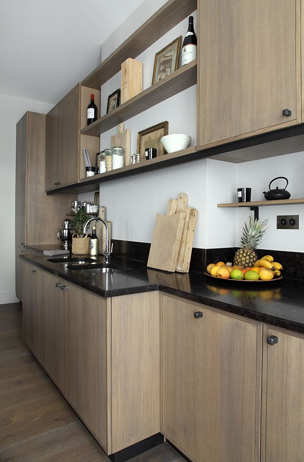 Greige wash on slab cabinet doors_dark quartz countertops and short back splash. There is a combination of open shelves an wall cabinets. Simple and elegant