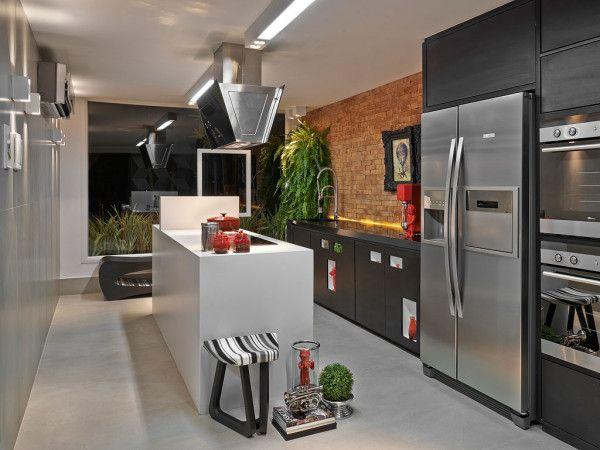 Cozinha moderna com um mistura interessante de materiais cimento queimado +  # Ilha Cozinha Tijolo
