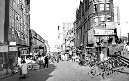 Old picture of Surrey Street Market from end where the flower stalls are now. Millets really has been on this corner forever!