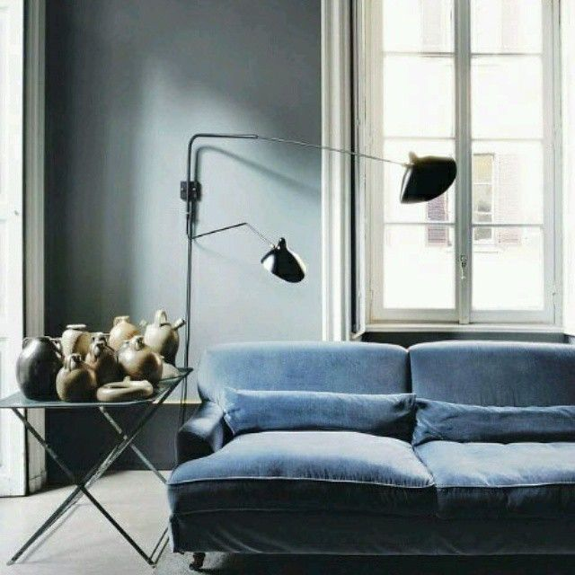 blue couch sofa living room space interior design home light spacious airy open pastels table concrete modern