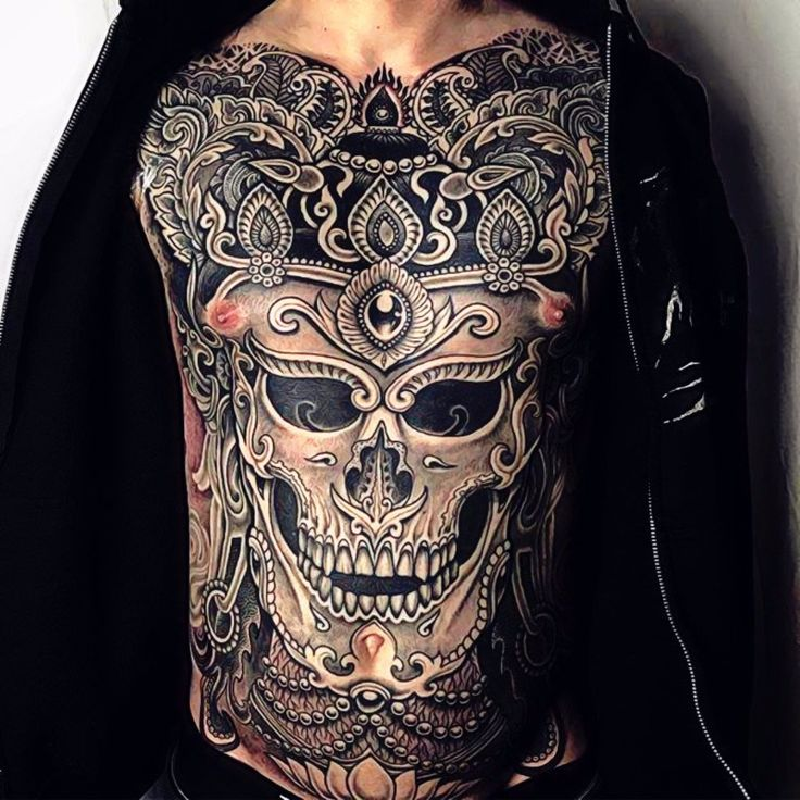 Amazing chest tattoo by Jondix.