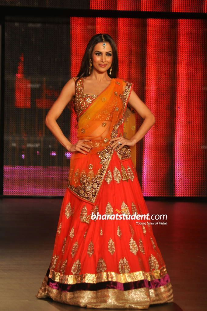 Vikram Phadnis.. love the color of the whole outfit.. and i love that lehnga..