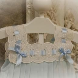 Sweet eyelet and ribbons. nice in white for beach portrait. wonder if this could be a yoke overlay for Butterick pattern B4176