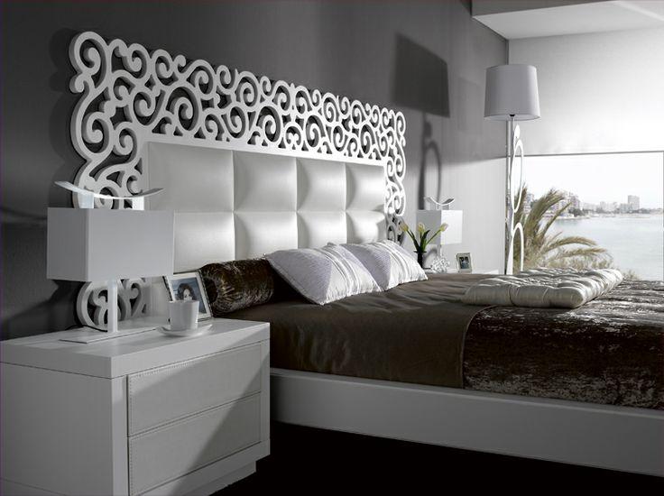 Dormitorio frontales y cabecero tapizado en piel sintética y combinado en blanco