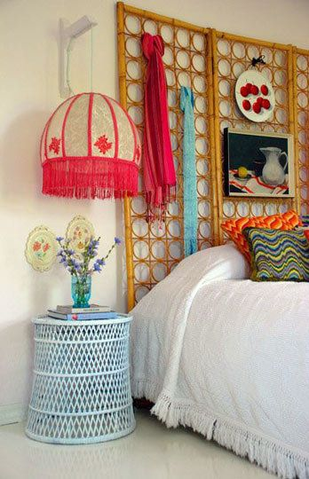 love the fun eclectic colors and textures of this bedroom, especially the unique headboard