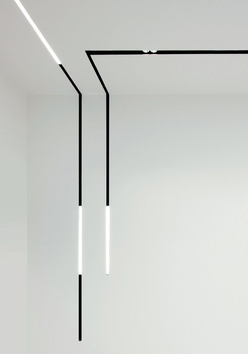 Continuous running lighting lines embedded diffused tubular recessed directional ceiling lights clean black