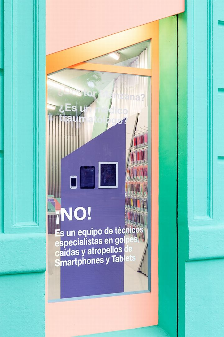 "Doctor Manzana mobile store by Masquespacio, Valencia – Spain » Retail Design Blog Looking at the store everything starts from the striking façade that incorporates the same angles and colors like for the graphic identity. The blue and green colors like a reference to the doctor, the salmon color for the fashionistas and the purple for the freaks. Both windows contain texts like ""Doctor Manzana? Is it an orthopedic doctor? No! It's a team of technicians specialized in smashes, drops and…"