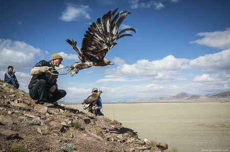 resurfacing memories: eagle hunters Photo by Jan Rockar — National Geographic Your Shot