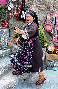 A woman sells handicrafts in Olympos, Karpathos...