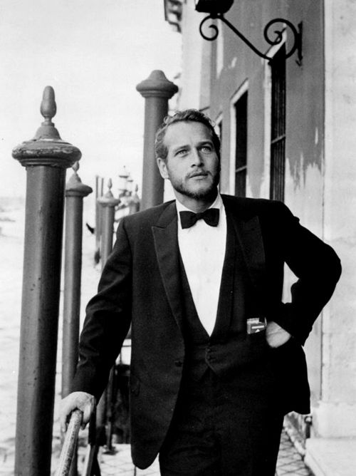 Paul Newman, in a dinner jacket back in the day, in what looks like Venice.