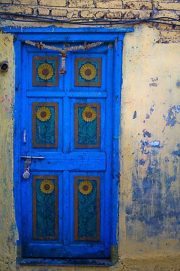 Blue door to home. (one hell of a lock on that there door, though...curious about it being on the outside...)