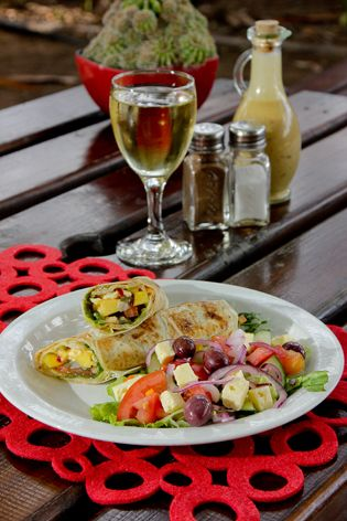 Vegetarian Wrap option at #Safari #Cafe. We use pineapple, cucumber and avocado to make a healthy crisp wrap served with a side salad.