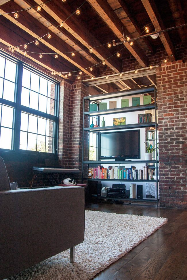 Love the lights!  Our Midwestern Studio Loft: A Tour by These Are Things