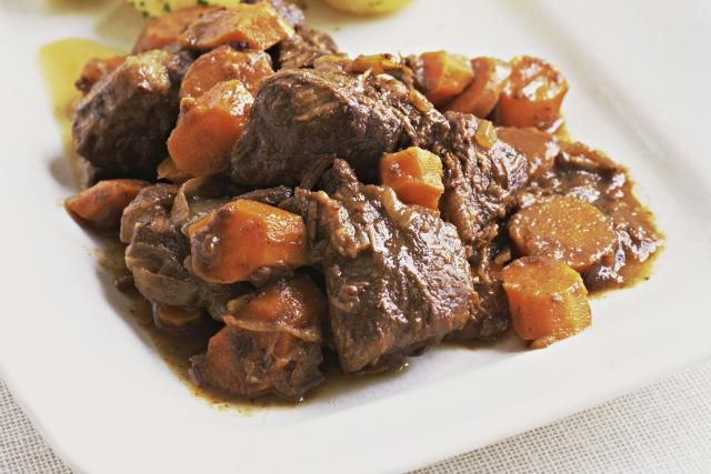 This is a crockpot beef stew recipe. Among the ingredients in this beef stew are potatoes, carrots, onion soup mix, seasonings, and tomato paste and peas.