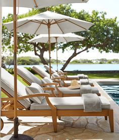 Pool Furniture Ideas grass grey stone paving gorgeous pool furniture and i love the potted flowers Relaxing By The Pool I Love White Umbrellas And Cushions By The Pool Pool Furniturefurniture Ideaschaise