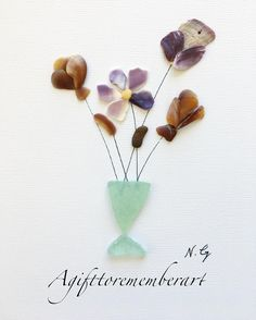 """ sea-glass vase"" another design of the flower and the sea glass vase! Love the natural colors of the shells and the sea-glass! #agifttorememberart #pebbleart #seaglass #shells #roomdecor #australia #adelaide #nature #etsy #instaart #instagood #instaphoto #photooftheday #art #artoftheday #interiordesign #handmade #gift #frame #madebyme #neshatghaffari #flower #craft #etsyseller #recycledart #spring #naturalcolor #beach"