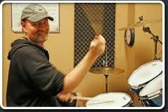 Neal Busby has a deep history of playing and teaching drums and has been a part of gold / platinum and Juno award winning artists like Slik Toxik and the Touring Drummer for April Wine …Being a long term instructor he has taught many hi-profile drummers like Neil Sanderson from Three Days