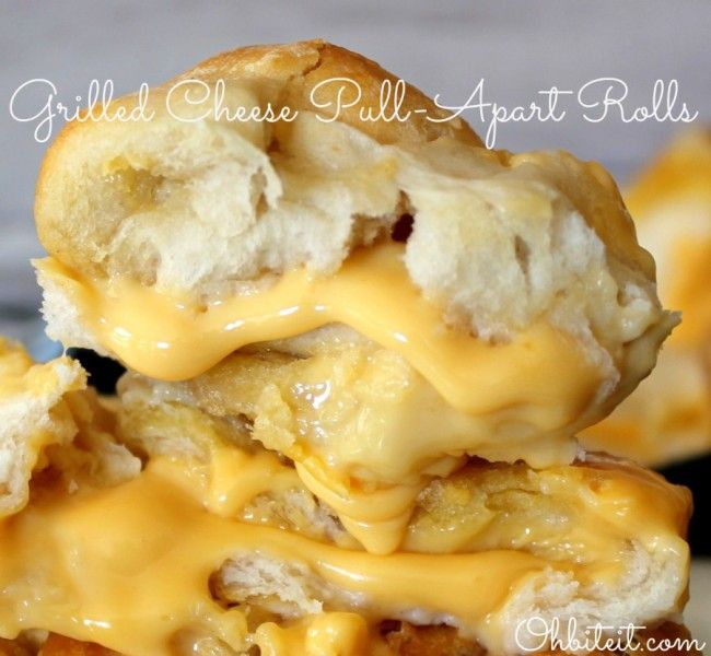 """Grilled Cheese pull aparts Pillsbury biscuits, Velveeta Cheese and Butter! Stuff each biscuit with a 1-2"""" cube of velveeta. Then put in a pan with melted butter in the bottom! Then put butter on top of them as well! Put in a 350 degree oven for 12 min uncovered the cover and bake for another 12-15 min!  Enjoy!"""