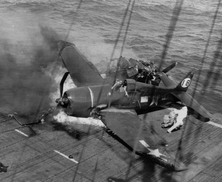 PACIFIC WAR - EMERGENCY LANDING ON AIRCRAFT CARRIER...guy in white is the Hotsuitman....pulls pilot out, puts out fire, etc; I did that on my ship.