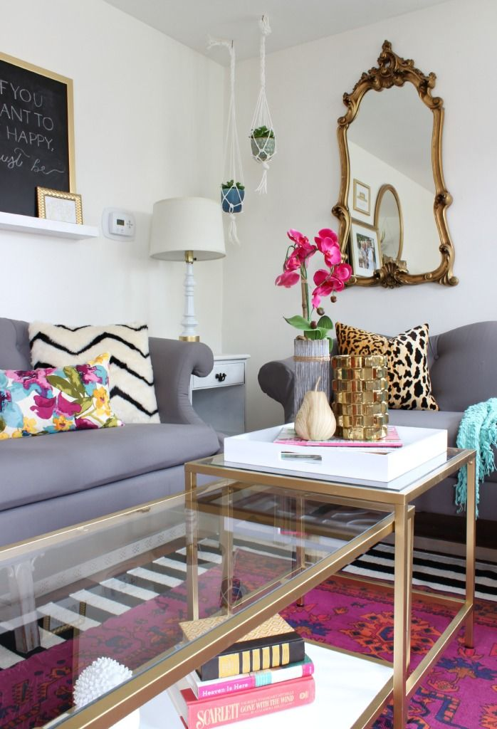 Living Room Makeover with jewel tones that is gorgeous. Additions of black, white, and gold made the room even more fabulous! Click for more details