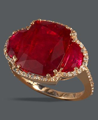 Ruby ... 3 stone (large, center, cushion-cut flanked by 2 fancy-cut, half circles) ... framed in a delicate edging of diamonds & set in rose gold ... STUNNING!!! ..... Did I mention that the ruby is my birthstone?!?