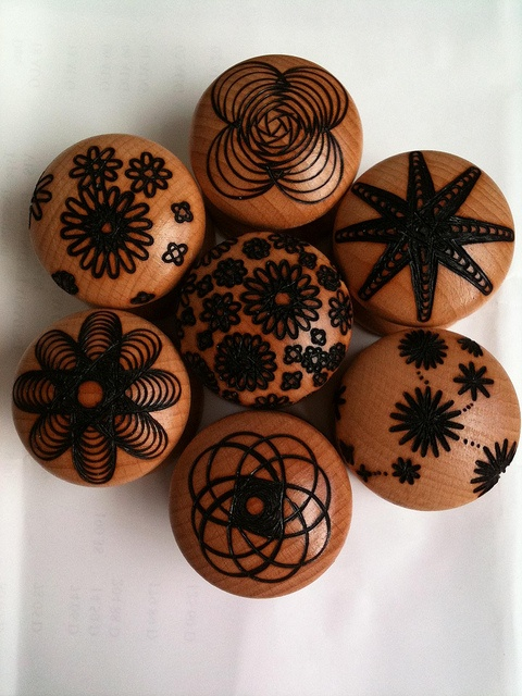 Big door knobs by Pyrography Jewellery, via Flickr