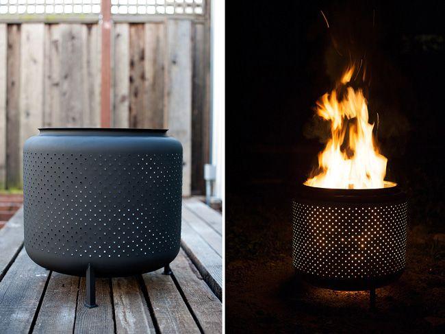 Convertir el tambor de una vieja lavadora en un fogón decorativo para el jardín.