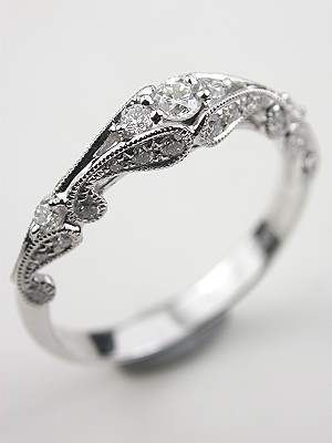 Swirling Diamond Wedding Band-- paired with a simple and dainty engagment ring.  Love it!