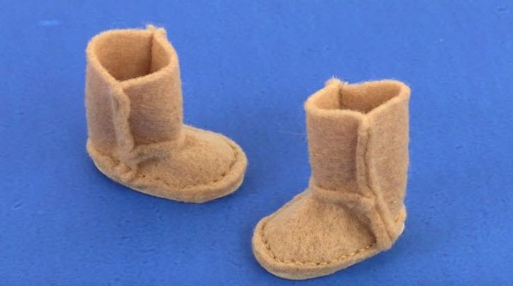 I am going to make a pair of boots for your doll like UGGS or bear paw using felt, craft foam, a needle, and thread, paper, and pencil for the pattern and glue. I start by taking the paper and pencil, and I make a rough sketch of what the boot look like. It would take four parts, so I sketch the pattern down below starting with the bottom of the shoe, the back, the top and the front. I developed this pattern trough trial and error, going back and re-adjusting until it worked. I've included a…