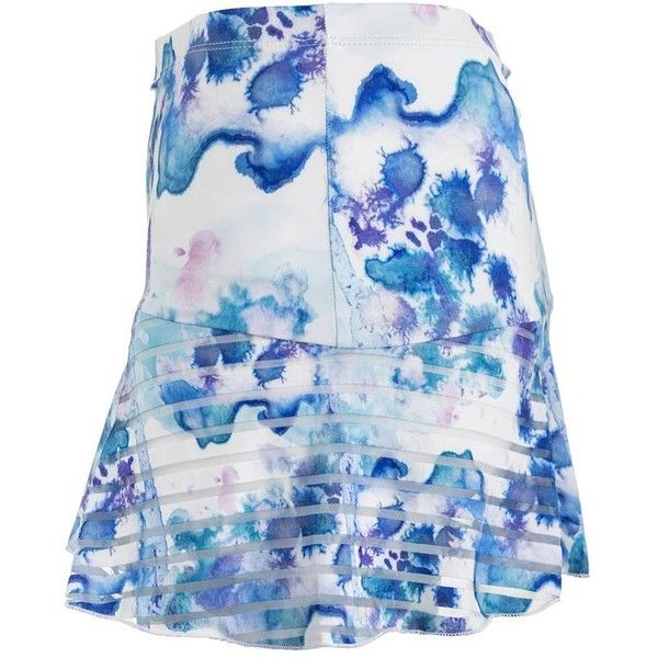 "You'll love the look and feel of Denise Cronwall Women's Trista Grace Tennis Skort! It's oh so feminine. The skort features a 14"" wide waist band with an athletic fit. The printed ruffles over the solid blue with a pearl-stitch finish. Designed and made in the USA plus UPF 40+ fabrication! Built-in shorts provide coverage underneath."