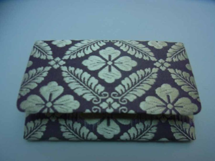 A purse made with heian patterned fabric.