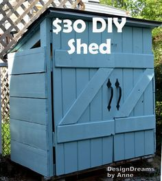 $30 was all  it cost to build this garbage can shed from reclaimed wood.