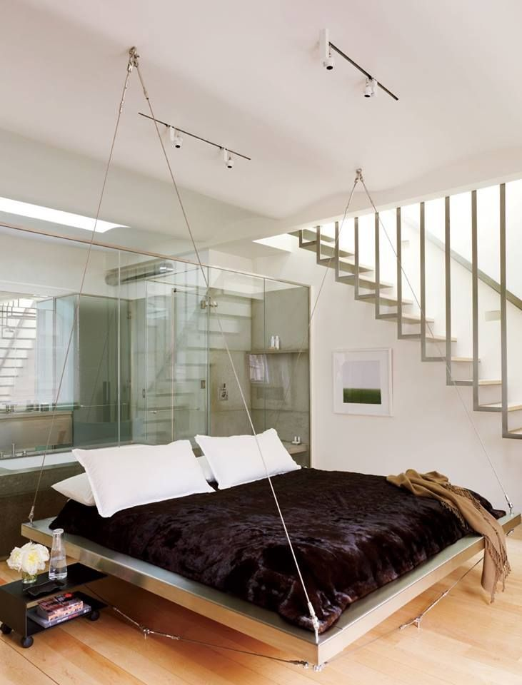 A floating bed decked with full glass panels as a back drop. Do you like this concept?