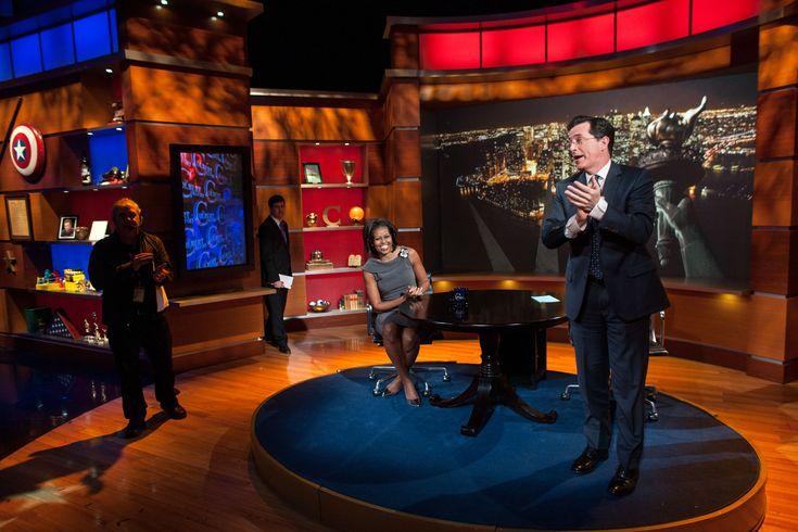 Steven Colbert talk show set reds/blues and wood tones