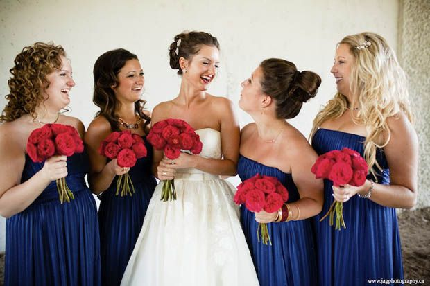 This, except maybe have the bride with blue flowers and bridesmaids with white..