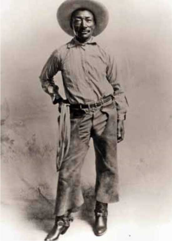 """Bill Pickett was born to Thomas Jefferson Pickett, a former slave, and Mary """"Janie"""" Gilbert, near Taylor, Texas in 1870. The family's ancestry was African-American and Cherokee. Bill remains most famous for inventing """"bulldogging"""", or the biting of the upper lip of steers to subdue them. As an African-American, Pickett could not compete against whites in rodeo competitions. Therefore, he would often be billed as Indian or remain unidentified to enable him to compete."""